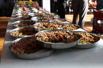 Plates of dried fruits and various nuts are offered to the Lord