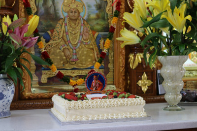 Delicious cake is offered to Lord Shree Swaminarayanbapa Swamibapa