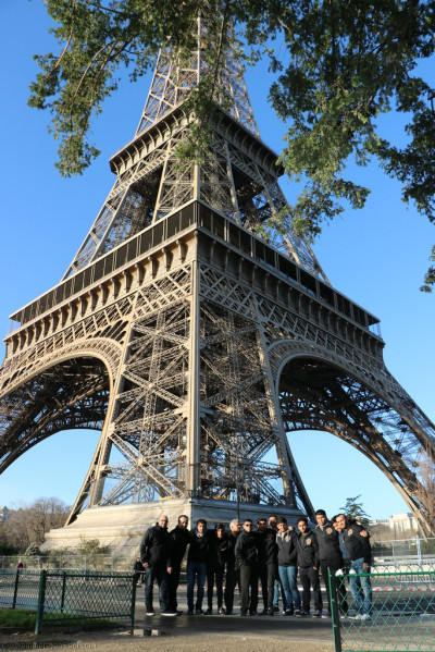 Disciples arrive at the base of the Eiffel Tower