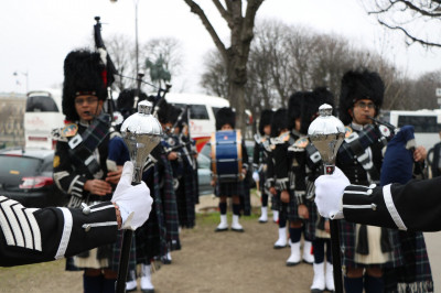 Shree Muktajeevan Swamibapa Pipe Band practice just before performing in La Grande Parade de Paris