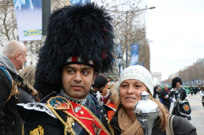 Members of Shree Muktajeevan Swamibapa Pipe Band Bolton pose with people who have come to watch the grand parade in Paris