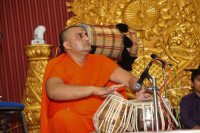 Sants perform tabla as part of the devotional song concert