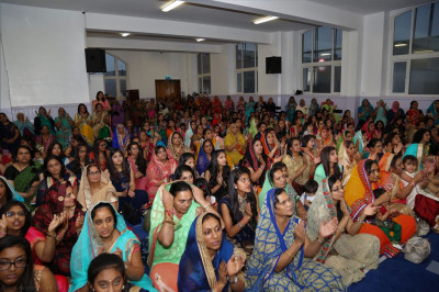 Hundreds of discples enjoy the devotional song concert