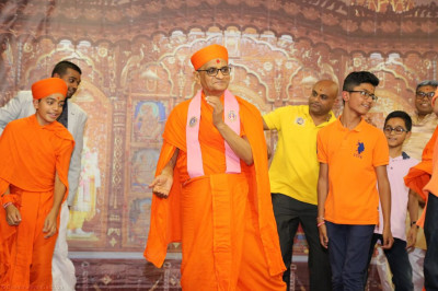 His Divine Holiness Acharya Swamishree dances with disciples on stage