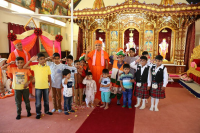 His Divine Holiness Acharya Swamishree blesses young disciples who took part in the performance