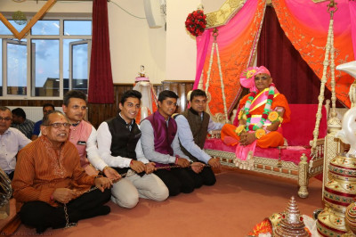 Disciples gently swing His Divine Holiness Acharya Swamishree