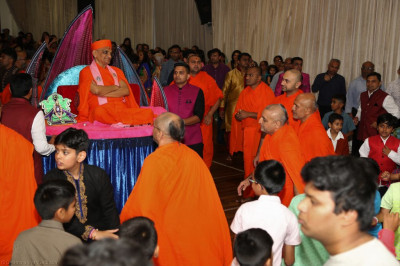 His Divine Holiness Acharya Swamishree blesses all as sants and disciples play raas
