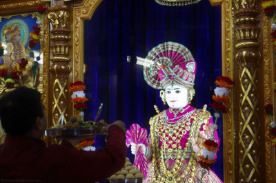 Divine darshan of Lord Shree Swaminarayan dining on various sweet and savoury dishes