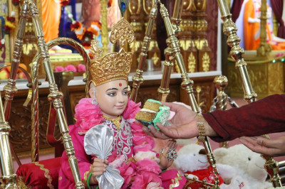 Divine darshan of Lord Shree Swaminarayan seated on a charming swing