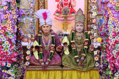 Divine Darshan of Lord Shree Swaminarayan & Jeevanpran Shree Abji Bapashree Seated on a Swing