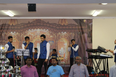 Disciples Play Various Instuments and Sing Devotional Songs During Raas<br>