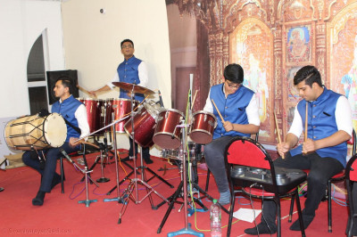 Disciples Play Various Instuments and Sing Devotional Songs During Raas