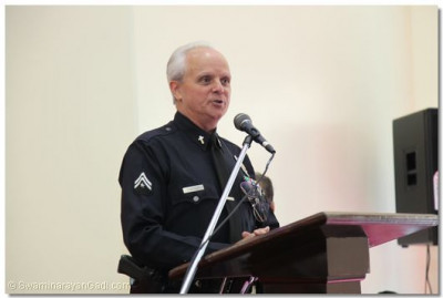 LAPD Van Nuys Captain gives a speech expressing His excitement to be at the grand opening of the temple