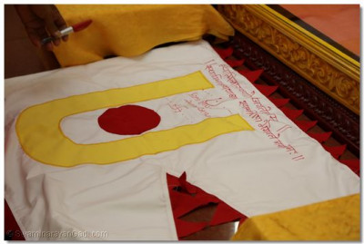 The first ever dhaja (flag) of Shree Swaminarayan Temple Los Angeles, California sanctified and signed by Acharya Swamishree