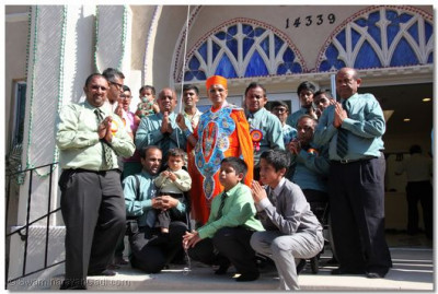 Disciples alongside Acharya Swamishree after the unveiling of the dhaja