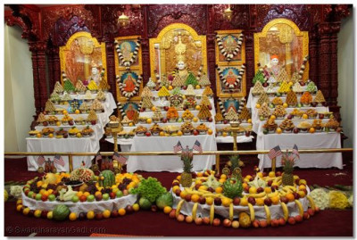 The first-ever annkut at Shree Swaminarayan Temple Los Angeles, California consisting of various Indian sweets, snacks, and assorted fruits with intricate carvings