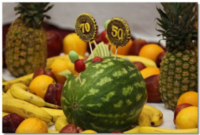 A watermelon design staked with candy lollipops that mark Acharya Swamishree's 70th manifestation day anniversary and 50th diksha din
