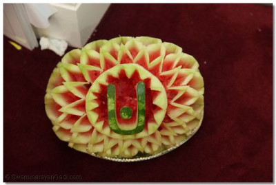 An intricate tilak chandlo carved from a watermelon