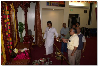 Devotees Performing Aarti at the end of Mahapuja