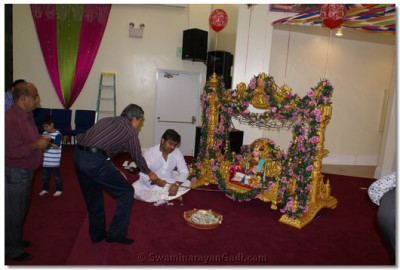 Disciples offering to swing Lord Shree Swaminarayan