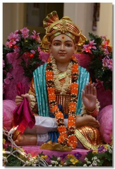 Divine darshan of Lord Shree Swaminarayan in ornate Swing