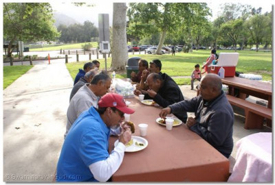 Disciples enjoying prasad prepared at the park
