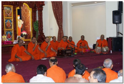 Santo reciting Kirtans to please Lord Shree Swaminarayan