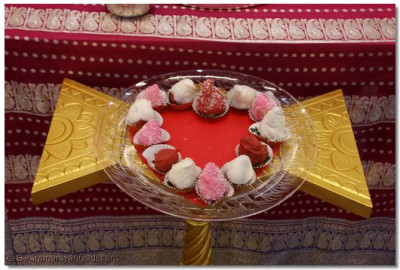 Sweet covered Strawberries offered to Lord in Heart shape for Valentine's Day Celebration