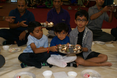 Young disciples participating in mahapooja