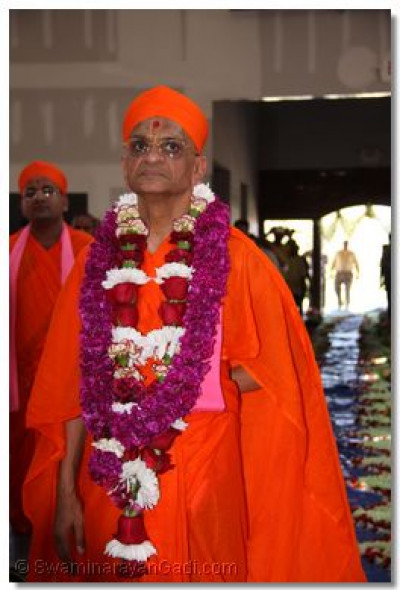 Acharya Swamishree looks at the temple�s progress as he walks into the temple