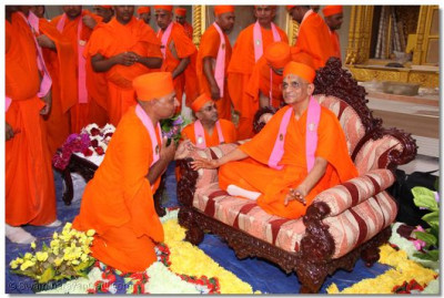 Acharya Swamishree blesses Shree Divyacharandasji Swami, one of the several sants who have been working tireless at the temple site since early June