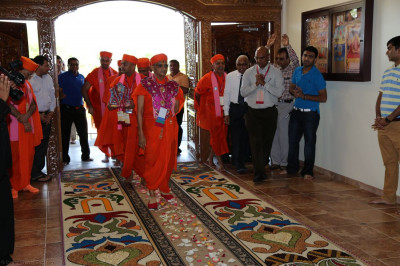 Acharya Swamishree enters Shree Swaminarayan Gadi Temple and is welcomed with intricate rangoli decoration