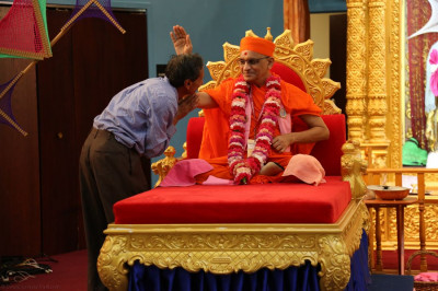 Acharya Swamishree gives His darshan to a local disciple