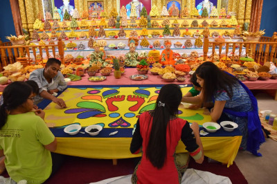 Disciples create intricate colourful rangoli patterns
