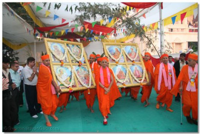 Having completed the havan ceremony, the Murtis are carried into the temple to be installed by Acharya Swamishree