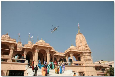 A helicopter sprays fragrant rose petals over the temple as the Murti Pratishtha ceremony concludes