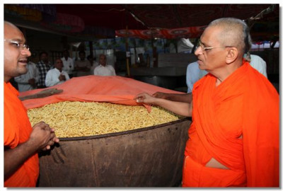 Acharya Swamishree inspects the raw food ingredients that will be used to make food for the thousands of people who attend the festival