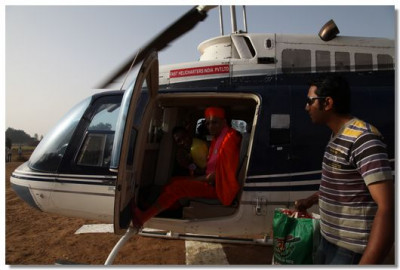Acharya Swamishree gives darshan in a helicopter