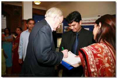 Guests provide their names to receive a special mememto written in Gujarati