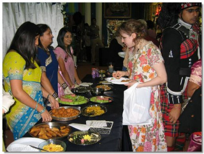 A guest tries a selection of Indian delicacies