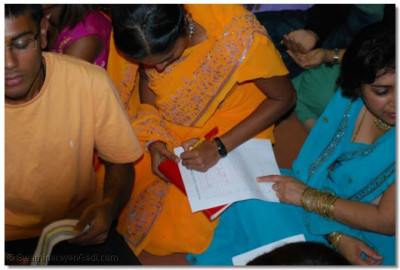 Teams write down their answers for the Mixed Kirtans competition