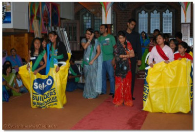 Team Acharya Swamishree and Team Gopal Bapa in action in the Sack Race