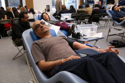 Members of the local community and disciples donate blood
