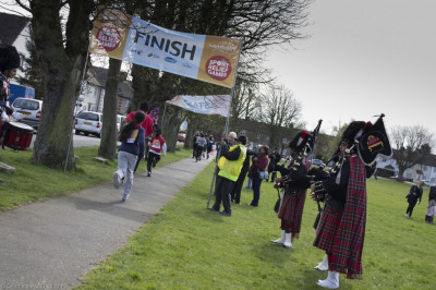 Members of Shree Muktajeevan Pipe Band perform to entertain all at the finish line