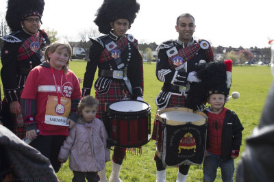 Local residents with members of Shree Muktajeevan Pipe Band