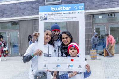 Participants pose with the twitter board