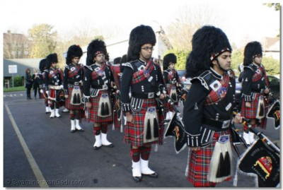 Shree Muktajeevan Pipe Band await the start of the procession