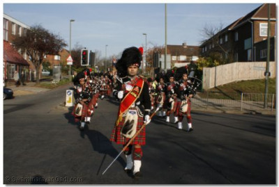 Shree Mukatjeevan Pipe Band march through the streets of London