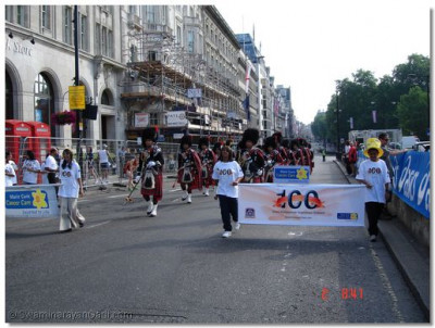 Shree Muktajeevan Pipe Band marches along Piccadilly before the Race commences