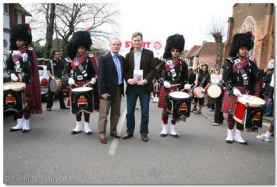 Guests Cllr. Matthew Offord and Cllr. Mike Freer enjoy the SMPB drummers fanfare